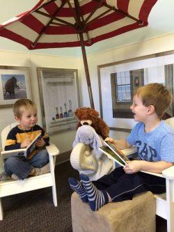 Wyatt and Cullough reading under umbrella