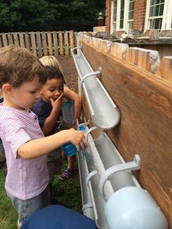 Henri and Adrian with water tube